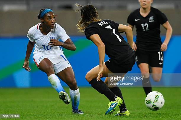 Crystal Dunn of the United States passes around Alie Riley of New Zealand during the second half of the United States' 20 first round Rio 2016 group...