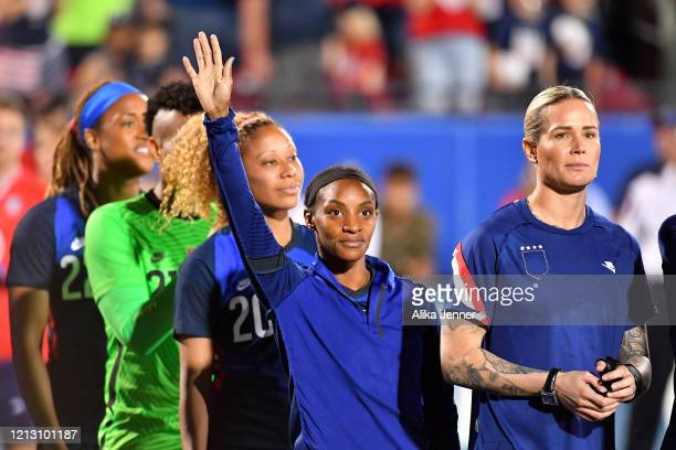 Crystal Dunn of the United States waves to fans after the SheBelieves Cup match against Japan at Toyota Stadium on March 11 2020 in Frisco Texas The...