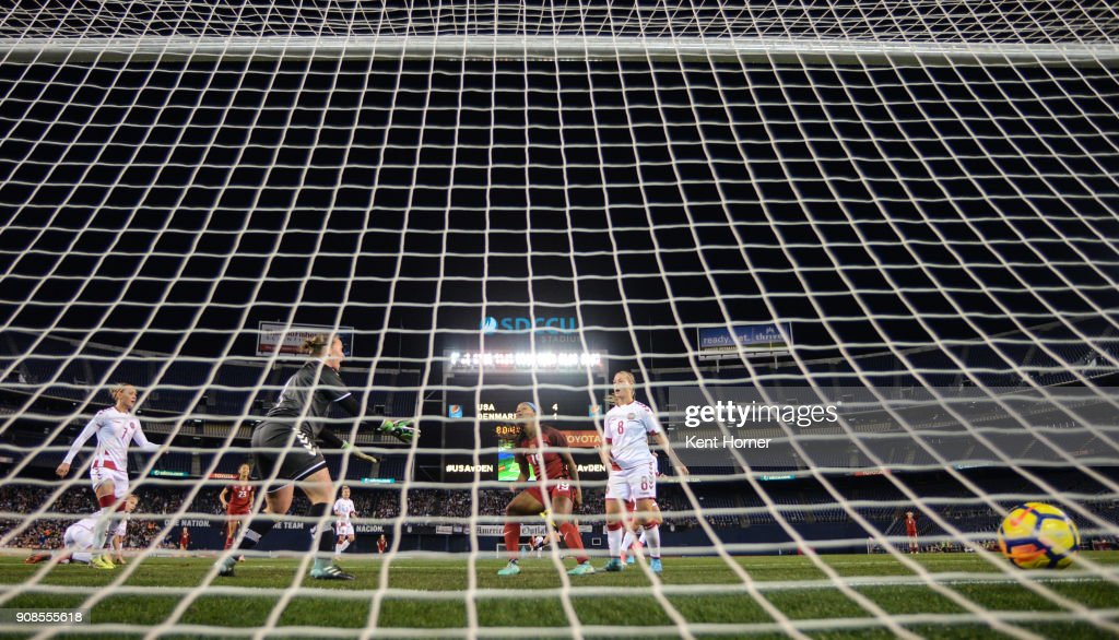 Crystal Dunn #19 of the U.S. women's national team scores a goal during the second half as gaol keeper Stina Lykke Petersen #0 of the Danish women's national team reacts at SDCCU Stadium on January 21, 2018 in San Diego, California.