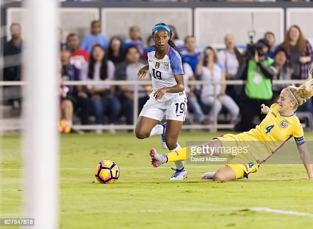 Crystal Dunn of the USA plays in a soccer game against Romania on November 10 2016 at Avaya Stadium in San Jose California Defending is Ioana Bortan...