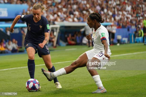 Crystal Dunn of the USA tackles Marion Torrent of France during the 2019 FIFA Women's World Cup France Quarter Final match between France and USA at...