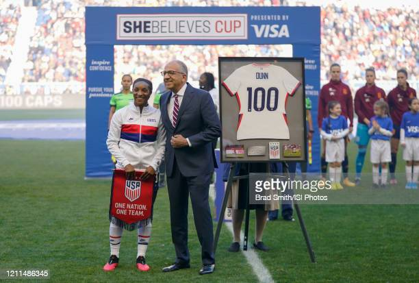 Crystal Dunn of the USWNT and her family along with US Soccer President Carlos Cordeiro celebrate her 100th cap during a game between Spain and USWNT...