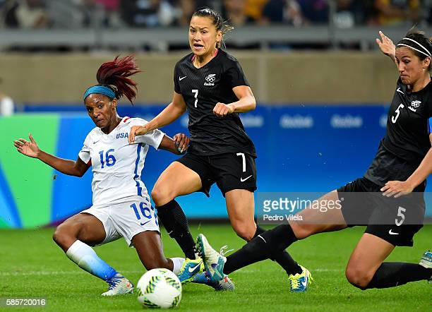Crystal Dunn of United States battles for the ball against Ali Riley and Abby Erceg of New Zealand in the Women's Group G first round match between...