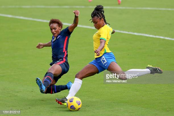 Crystal Dunn of United States blocks a shot attempt by Ludmila of Brazil during the first half of the SheBelieves Cup at Exploria Stadium on February...