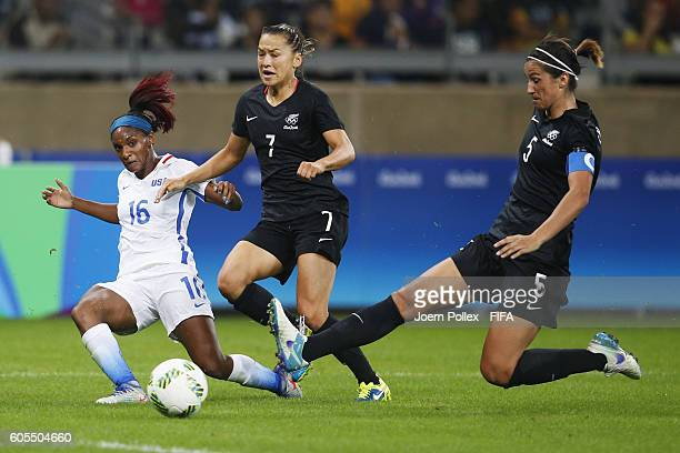 Crystal Dunn of USA and Ali Riley and Abby Erceg of New Zealand compete for the ball during Women's Group G match between USA and New Zealand on Day...