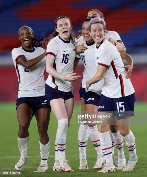 Crystal Dunn, Rose Lavelle, Christen Press and Megan Rapinoe of Team United States celebrate following their team's victory in the penalty shoot out...