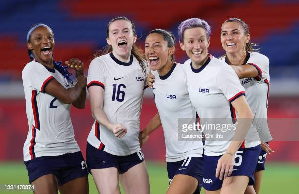 Crystal Dunn, Rose Lavelle, Christen Press, Megan Rapinoe and Alex Morgan of Team United States celebrate following their team's victory in the...