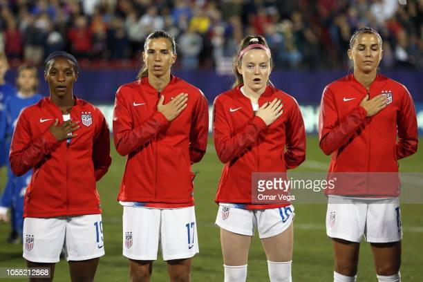 Crystal Dunn Tobin Heath Rose Lavelle and Alex Morgan of the United States stands during the National Anthem before the semifinals match between...