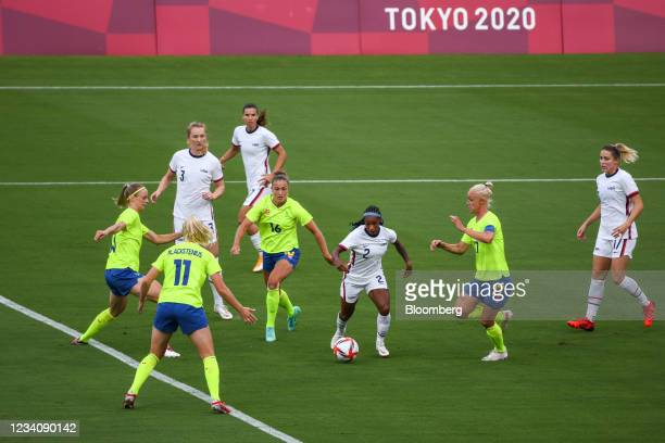 Crystal Dunn, U.S. Football player, center, controls the ball during an opening round women's football match between the U.S. And Sweden at the Tokyo...