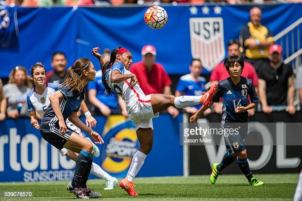 Crystal Dunn US Women's National Team received a pass while under pressure from Rumi Utsugi of Japan during the first half of a friendly match on...