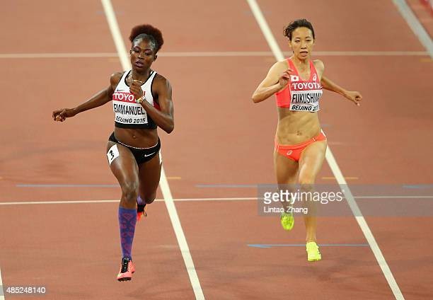 Crystal Emmanuel of Canada and Chisato Fukushima of Japan compete in the Women's 200 metres heats during day five of the 15th IAAF World Athletics...