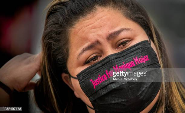 Crystal Galeano, best friend of Monique Munoz, cries while remembering her friend as she joins family, friends and supporters of Monique Munoz...
