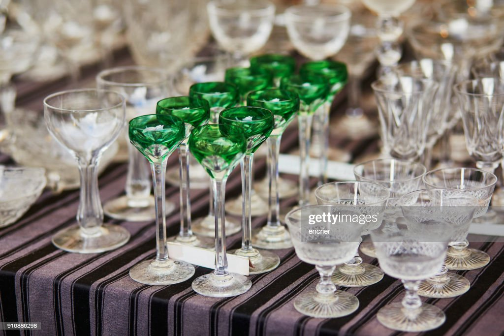 Crystal glasses on a flea market : Stock Photo
