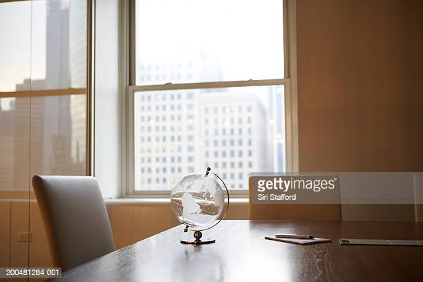 Crystal globe on table in office
