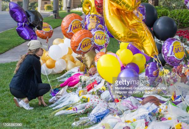 Crystal Gonsalves mourns the loss of Kobe Bryant at a make shift memorial outside the gates of the housing development where he lived in Newport...