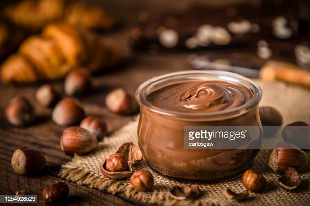 crystal jar full of hazelnut and chocolate spread - cream dairy product stock pictures, royalty-free photos & images