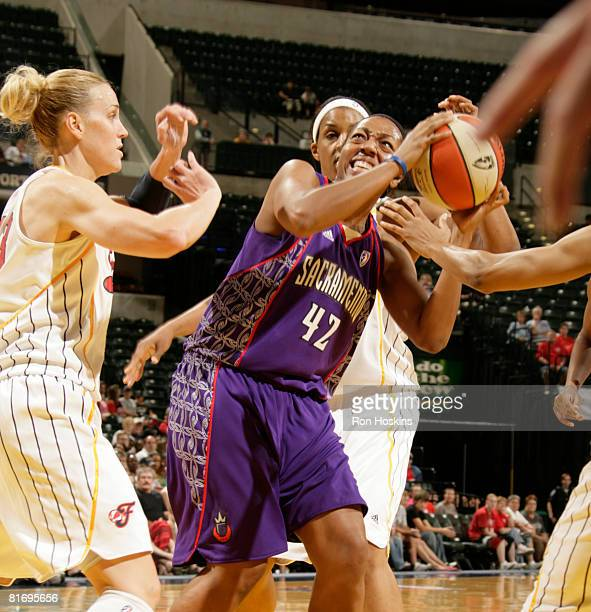Crystal Kelly of the Sacramento Monarchs battles Katie Douglas and Tammy SuttonBrown of the Indiana Fever at Conseco Fieldhouse June 24 2008 in...