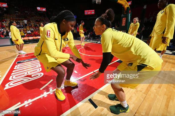 Crystal Langhorne and Jewell Loyd of the Seattle Storm dance on court before Game Three of the 2018 WNBA Finals against the Washington Mystics on...