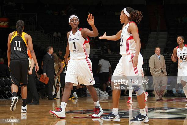 Crystal Langhorne and Monique Currie of the Washington Mystics celebrate against the Tulsa Shock at the Verizon Center on May 26 2012 in Washington...