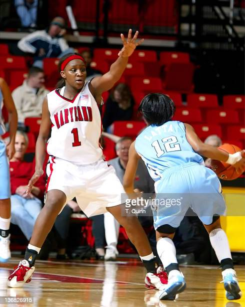 Crystal Langhorne holds up Ivory Latta during a game at Comcast Center in College Park MAryland on January 9 2005