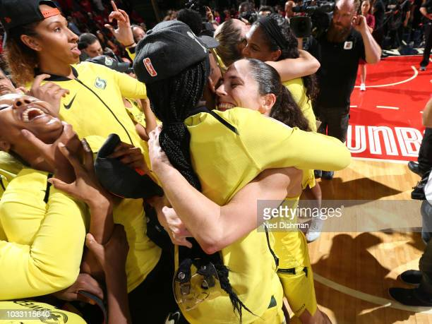 Crystal Langhorne hugs Sue Bird of the Seattle Storm after winning the WNBA Championship against the Washington Mystics during Game Three of the 2018...