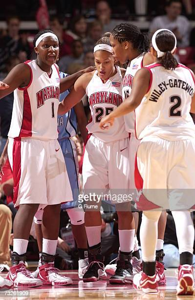 Crystal Langhorne Marissa Coleman Laura Harper and Sa'de WileyGatewood of the Maryland Terrapins huddle during the game against of the North Carolina...