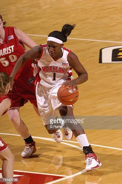 Crystal Langhorne of the Maryland Terrapins drives to the hoop against Marist Red Foxes December 30 2006 at Comcast Center in College Park Maryland