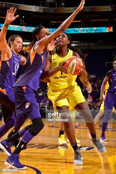 Crystal Langhorne of the Seattle Storm drives to the basket against the Phoenix Mercury during a preseason game on May 12 2018 at Talking Stick...