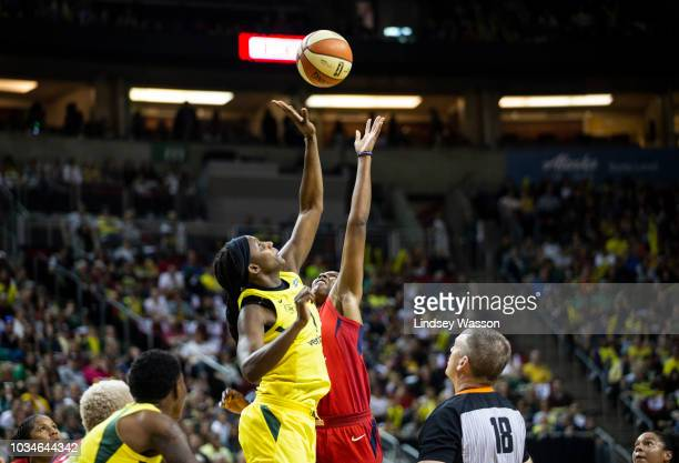 Crystal Langhorne of the Seattle Storm gets the tip on the jump ball against Ariel Atkins of the Washington Mystics but the Mystics gain possession...