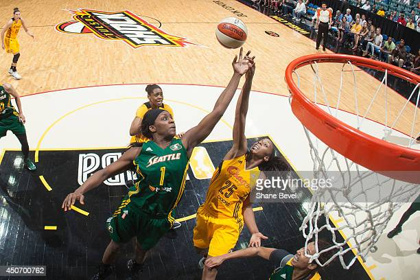 Crystal Langhorne of the Seattle Storm reaches for a rebound against Glory Johnson of the Tulsa Shock during the WNBA game on June 15 2014 at the BOK...