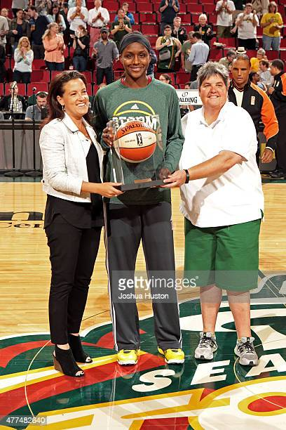 Crystal Langhorne of the Seattle Storm recieves an award before a game against the Connecticut Sun on June 16 2015 at Key Arena in Seattle Washington...