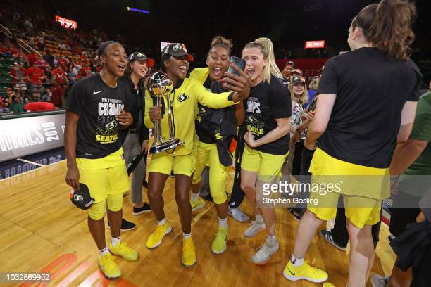 Crystal Langhorne of the Seattle Storm takes a selfie with her team after winning Game Three of the 2018 WNBA Finals against the Washington Mystics...