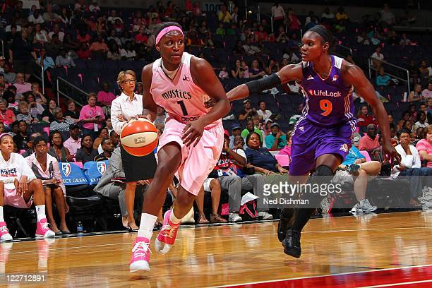 Crystal Langhorne of the Washington Mystics drives against Marie FerdinandHarris of the Phoenix Mercury at the Verizon Center on August 28 2011 in...