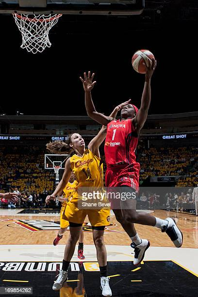 Crystal Langhorne of the Washington Mystics drives to the basket against Kayla Pedersen of the Tulsa Shock during the WNBA game on May 27 2013 at the...