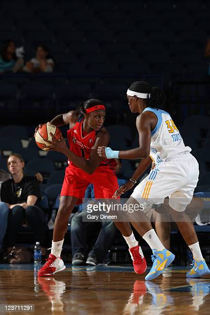 Crystal Langhorne of the Washington Mystics protects the ball against the Chicago Sky and the Chicago Sky on August 26 2011 at the AllState Arena in...