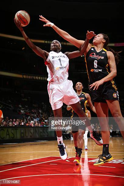 Crystal Langhorne of the Washington Mystics shoots against Liz Cambage of the Tulsa Shock at the Verizon Center on June 30 2013 in Washington DC NOTE...