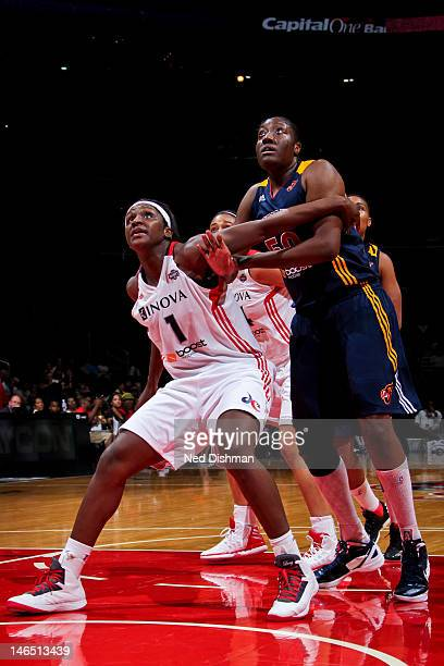 Crystal Langhorne of the Washington Mystics tries for rebound position against Jessica Davenport of the Indiana Fever at the Verizon Center on June...