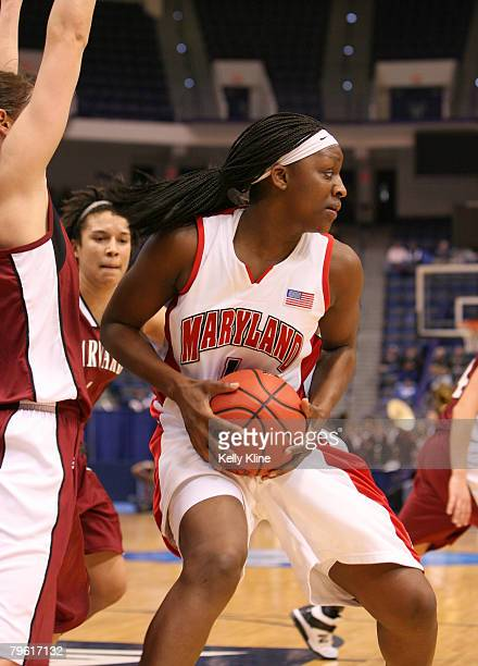 Crystal Langhorne posts up on the block in the second half during the NCAA Women's Basketball Tournament first round matchup between the Harvard...