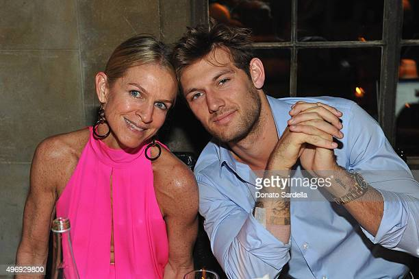 Crystal Lourd and Alex Pettyfer join NETAPORTER as they celebrate Hollywood style at Chateau Marmont on November 12 2015 in Los Angeles California