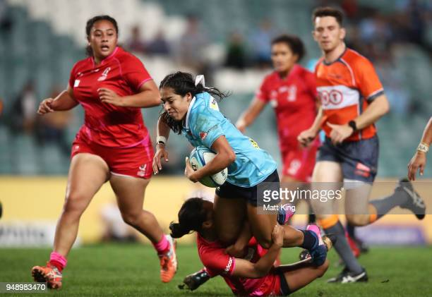 Crystal Maguire of New South Wales is tackled during the Super W Grand Final match between the the New South Wales Women and the Queensland Women at...