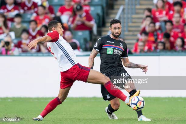 Crystal Palace defender Damien Delaney fights for the ball with West Bromwich Albion midfielder Jake Livermore during the Premier League Asia Trophy...