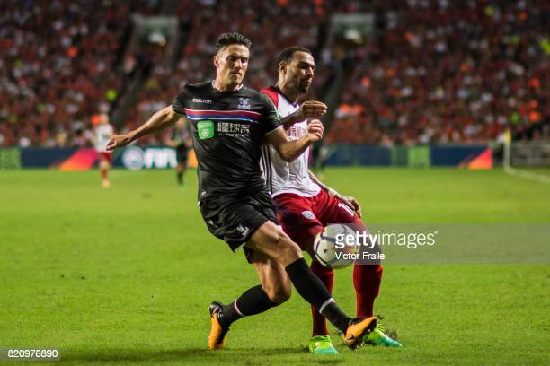 Crystal Palace defender Martin Kelly fights for the ball with West Bromwich Albion midfielder Matt Phillips during the Premier League Asia Trophy...