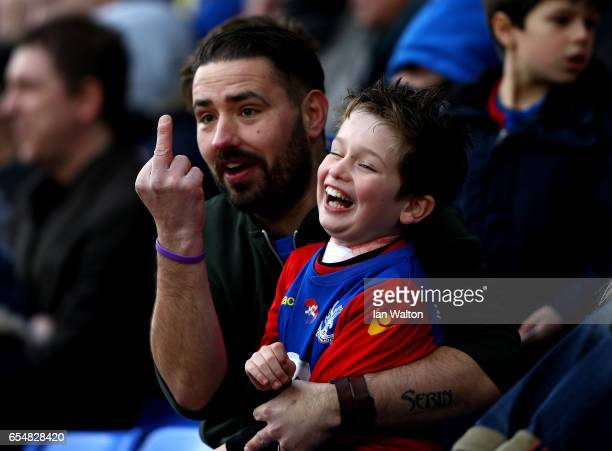 Crystal Palace fan and his son gesture towards the Watford players during the Premier League match between Crystal Palace and Watford at Selhurst...