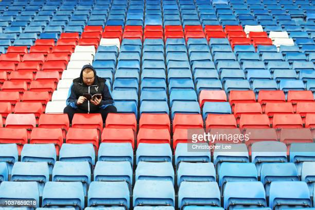Crystal Palace fan waits inside the stadium prior to the Premier League match between Crystal Palace and Newcastle United at Selhurst Park on...