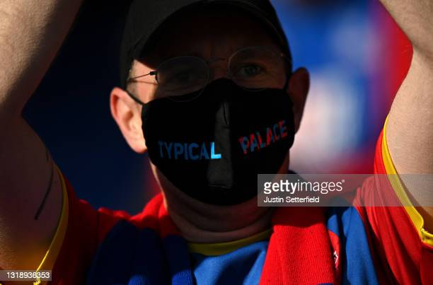 Crystal Palace fan wearing a palace face mask during the Premier League match between Crystal Palace and Arsenal at Selhurst Park on May 19, 2021 in...