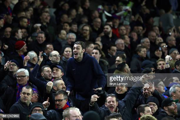 Crystal Palace fans attend the Premier League match between Brighton and Hove Albion and Crystal Palace at Amex Stadium on November 28 2017 in...