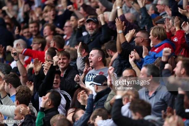 Crystal Palace fans celebrate a goal during the Premier League match between Crystal Palace and Chelsea at Selhurst Park on October 14 2017 in London...