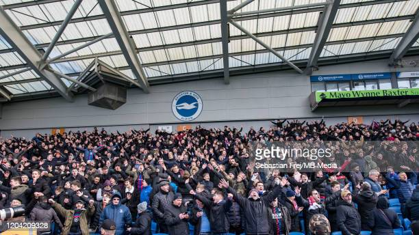 Crystal Palace fans celebrate during the Premier League match between Brighton Hove Albion and Crystal Palace at American Express Community Stadium...