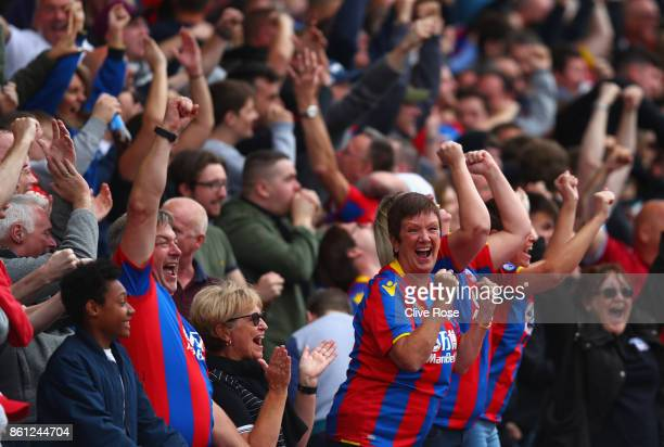 Crystal Palace fans celebrate there sides goal during the Premier League match between Crystal Palace and Chelsea at Selhurst Park on October 14 2017...