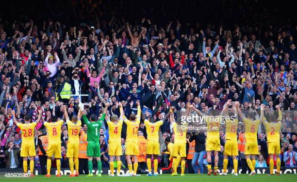 Crystal Palace fans celebrate victory with their fans during the Barclays Premier League match between West Ham United and Crystal Palace at Boleyn...